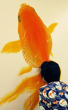 Japanese artist Riusuke FUKAHORI painting his goldfish on the wall