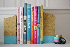 Dipped brick bookends - spray paint uneven bricks gold, tape off with painters tape, and dip into another color