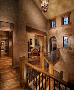 Mediterranean Home Exposed Stone Or Brick Interior Design....would love this on just one wall...