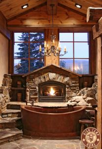 Loving this Cabin bathtub with fireplace!