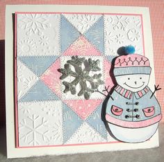 handmade card: Let it Snow, Let it Snow, Let it Snow by heather maria ... winter quilt card ... star pattern in pink and icy blue ... zig zag machine stitching around the star pieces .. luv the snowflake embossing folder texture on the border pieces ... cut snowman popped up on the side ... wonderful card!!