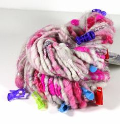 Handspun Art Yarn-Barbie's Closet- Signature SmoothSpun Artisan Yarn. $68.00, via Etsy.