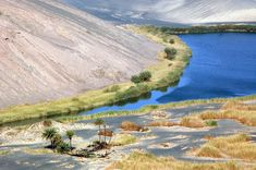 Waw an Namus: the inside of the caldera houses an oasis of rich foliage & 3 small salt lakes of variable color