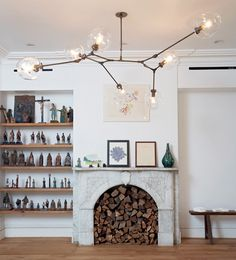 Lindsey Adelman chandelier living room fireplace