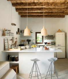 Jamaica barstools by Pepe Cortès for Knoll and two Ikea pendants pair nicely with the plaster walls, restored wooden beam ceilings, and p...