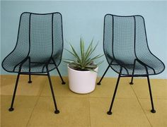 These cool metal chairs look so chic next to the simple white planter. Learn more about choosing the right patio furniture at: http://www.landscapingnetwork.com/patio-furniture/