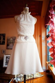 Two-piece bridal ensemble by Janice Martin Couture featuring a lace overlay halter top and a-line skirt. www.janicemartin.net
