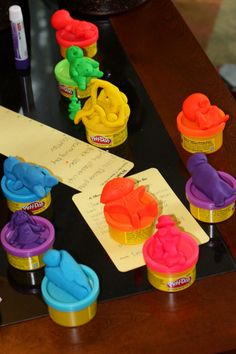 Guests make babies out of small containers of playdough. Mom-to-be picks her favorite.