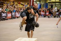 Travis Holly carrying Michael Winchester during the team wod