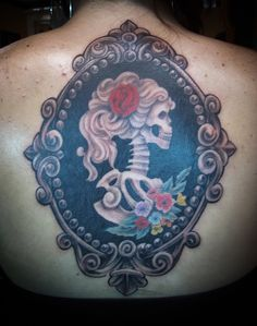 Skeleton Cameo Tattoo. To make it my own, the skeleton would have red hair with a black rose. The border would be completely different and there would be gears.