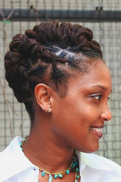 Locs twisted and styled. Stylish yet neat.