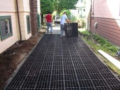 Installing a Green Parking Pad-A couple of fellows building a gravel driveway using ecogrid