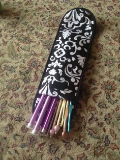 Thirty-One flat iron case used to hold knitting needles and crochet hooks. Check out my website to order!  www.mythirtyone.com/lizzieholt