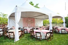 Ribbons and frames strung across the wall of the tent. Simple. Skip the pink