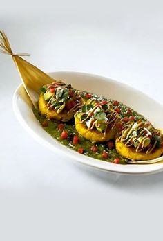 The Cheesecake Factory - Sweet Corn Tamale Cakes - Topped with Sour Cream, Salsa, Avocado and Salsa Verde.