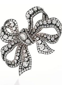 Silver-plated gold and diamond bow brooch, circa 1850.