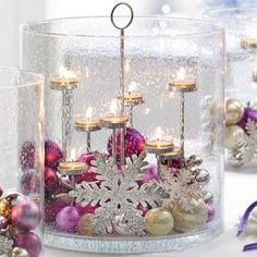 Majestic Hearth Hurricane by PartyLite® Candles. Mouth blown into a dramatic and ornate size, our hurricane is unforgetable gracing the hearth or entry table as a breath taking centerpiece. purple, silver, white, sparkles, snowflakes, tealights, ornaments, christmas, holiday, ribbon