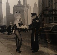 Bunny Pat Higgenbotham presents a @Playboy key cake to a cop on Michigan Ave #1962 #scrapbooksaturday