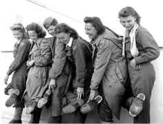 Flight nurses of the 807th Medical Air Evacuation Transport Squadron show off the holes in their shoes. Their plane went down in Nazi-occupied Albania on 8 November 1943, and they were rescued and returned to Italy 9 January 1944.