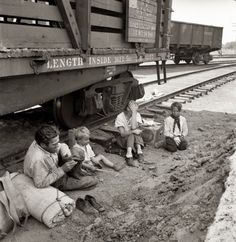 """August 1939. Agricultural migrants. """"Family who traveled by freight train. Toppenish, Washington. Yakima Valley.""""by Dorothea Lange"""