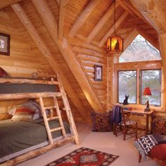Second floor bedroom is contained within a gable dormer created by log rafters.  White cedar log and paneling finish this space.