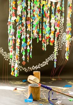 Colorful triangle paper garlands would make a cute photobooth backdrop. Just use recycled paper!
