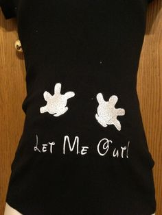 """Maternity Shirt with """"Let Me Out"""" in the Disney font and Gloves Pushing on the """"Bump"""". $30.00, via Etsy."""