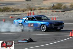 Jason Childress locks up the tires on his Ford Mustang at the 2011 #OUSCI