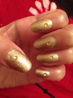 Gold on gold gel nails.