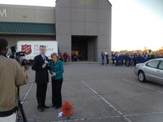 Terri Smith and Kay Bain doing a live shot from the Tupelo Auto Museum on the kickoff day of Food For Families.