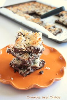Chocolate Coconut Bars are a yummy snack for everyone to munch on. The top is garnished with crunchy pecan pieces that add a lovely bit of nuttiness to the chocolate and coconut flavors. Serve these to your guests – they're sure to be delighted.