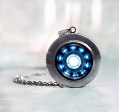 Iron man Arc reactor locket.... This would be awesome!!