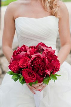 Red wedding bouquet with peonies and roses. Learn how to make your own wedding bouquet and save money. Visit www.bloomsbythebox.com