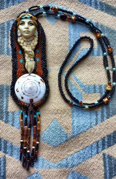 Laura Mears Indian princess cabochon surrounded by peyote stitch beadwork.