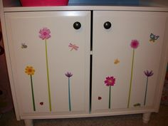 This was a plain white changing table I redid with dollar store stickers