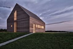The Summer House by Judith Benzer Architektur is built in the vast openness of the fields of Southern Burgenland, Austria.