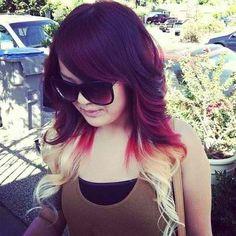 Dark red, blonde ombré curly hair.