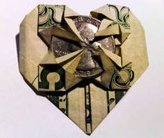 Instructions here: http://www.wikihow.com/Fold-a-Dollar-Into-a-Heart #origami