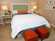Staging to sell - The white comforter is from Overstock.   The little square storage ottomans are the perfect little accent at the end of the bed, $49. The lamps are    from Target, $39. The side tables {Target} were originally a really bad creamy sponged treatment that    I sanded and painted white.$79.
