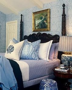 Barclay Butera ~ Black headboard along with white and blue for the bedroom.
