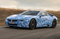 BMW i8 plug-in hybrid sports car that will be presented during the Frankfurt Auto Show running through Sept. 22, 2013. BMW use carbon fiber parts to achieve light weight and quick acceleration _ zero to 100 kph (0-62 mph) in 4.5 seconds.