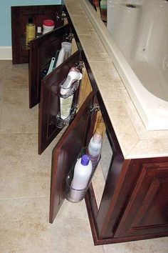 DIY Bathroom Storage Idea ~ Plastic bins were attached to the doors, allowing additional storage of everyday items, leaving the valuable cabinet space for larger items