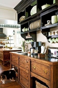 What a cozy feeling coffee bar for the kitchen. Love that overhead open shelving piece!