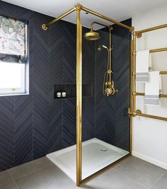 Bathroom with Black Herringbone tiles on wall via @drummonds_bathrooms