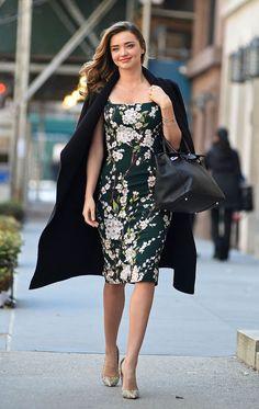 Miranda Kerr wore a  Dolce & Gabbana floral print dress layered under a fall 2014 Escada coat