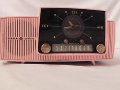 Vintage 1950's Pink General Electric Alarm Clock Radio - RESERVED. $50.00, via Etsy.