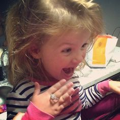 How ADORABLE is this little girl trying on her aunt's new engagement ring!?!?