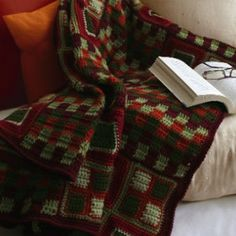 Need Christmas crochet patterns? This Patchwork Crochet Blanket is perfect for the Christmas season. It's the coziest Christmas craft you've ever seen! | AllFreeCrochetAfghanPatterns.com