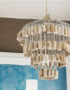 Wine Cork Chandelier I am thinkin' it would be cool to combine with pieces of glass for a wind chime, ot tag the corks with metal tags embossed with special dates or names, etc...variation on a theme you know...