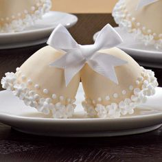 Tolling for Two Mini Cakes - Ring in upcoming nuptials! Create bell-shaped cakes in our Brownie Pops 8-Cavity Silicone Mold. Add piped icing flowers and a ribbon bow to prettify the candy-coated partners.